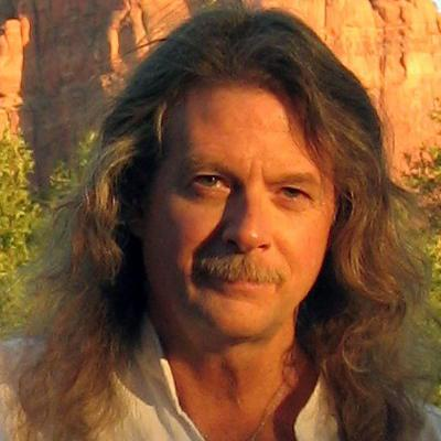 photo of Scott Beck, who has long hair and a moustache